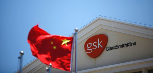 File photo of a Chinese national flag fluttering in front of a GlaxoSmithKline (GSK) office building in Shanghai