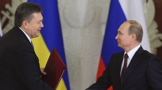 Russia's President Putin and his Ukrainian counterpart Yanukovich shake hands as they attend a signing ceremony after a meeting of the Russian-Ukrainian Interstate Commission at the Kremlin in Moscow