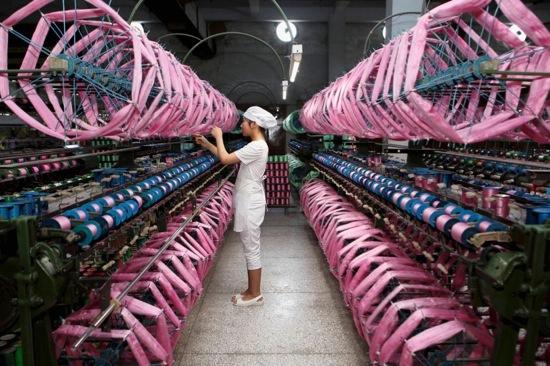 An employee works inside a silk factory in Neijiang