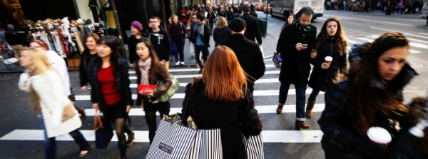 Holiday shoppers walk along 5th Avenue in New York