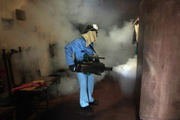 health-worker-fumigates-inside-home-eliminate-mosquitoes