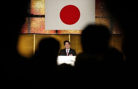 Japan's PM Abe makes a speech at a New Year party hosted by the Japan Business Federation, Japan Association of Corporate Executives and Japan Chamber of Commerce and Industry, in Tokyo