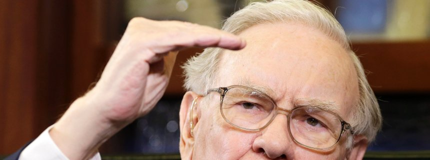 FILE - In this May 5, 2014 file photo, Berkshire Hathaway Chairman and CEO Warren Buffett gestures during an interview with Liz Claman on the Fox Business Network in Omaha, Neb. The stock price of Berkshire Hathaway topped $200,000 for the first time Thursday morning, Aug. 14, 2014. Class A shares of Berkshire jumped past the milestone to an all-time trading high of $201,625. (AP Photo/Nati Harnik, File)