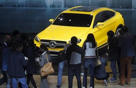 Visitors walk around a Mercedes Benz concept GLC Coupe car during the 16th Shanghai International Automobile Industry Exhibition in Shanghai, April 20, 2015. REUTERS/Carlos Barria