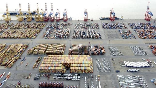 Cars and containers are pictured at a shipping terminal in the harbour of the German northern town of Bremerhaven, late October 8, 2012. REUTERS/Fabian Bimmer
