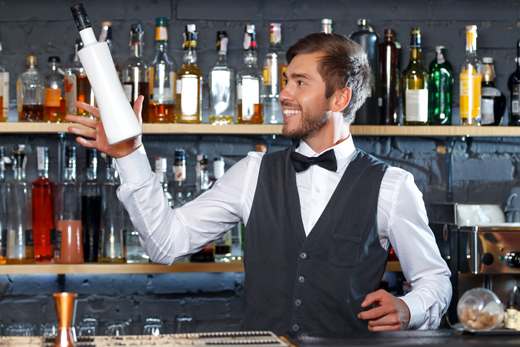 Handsome bartender during work