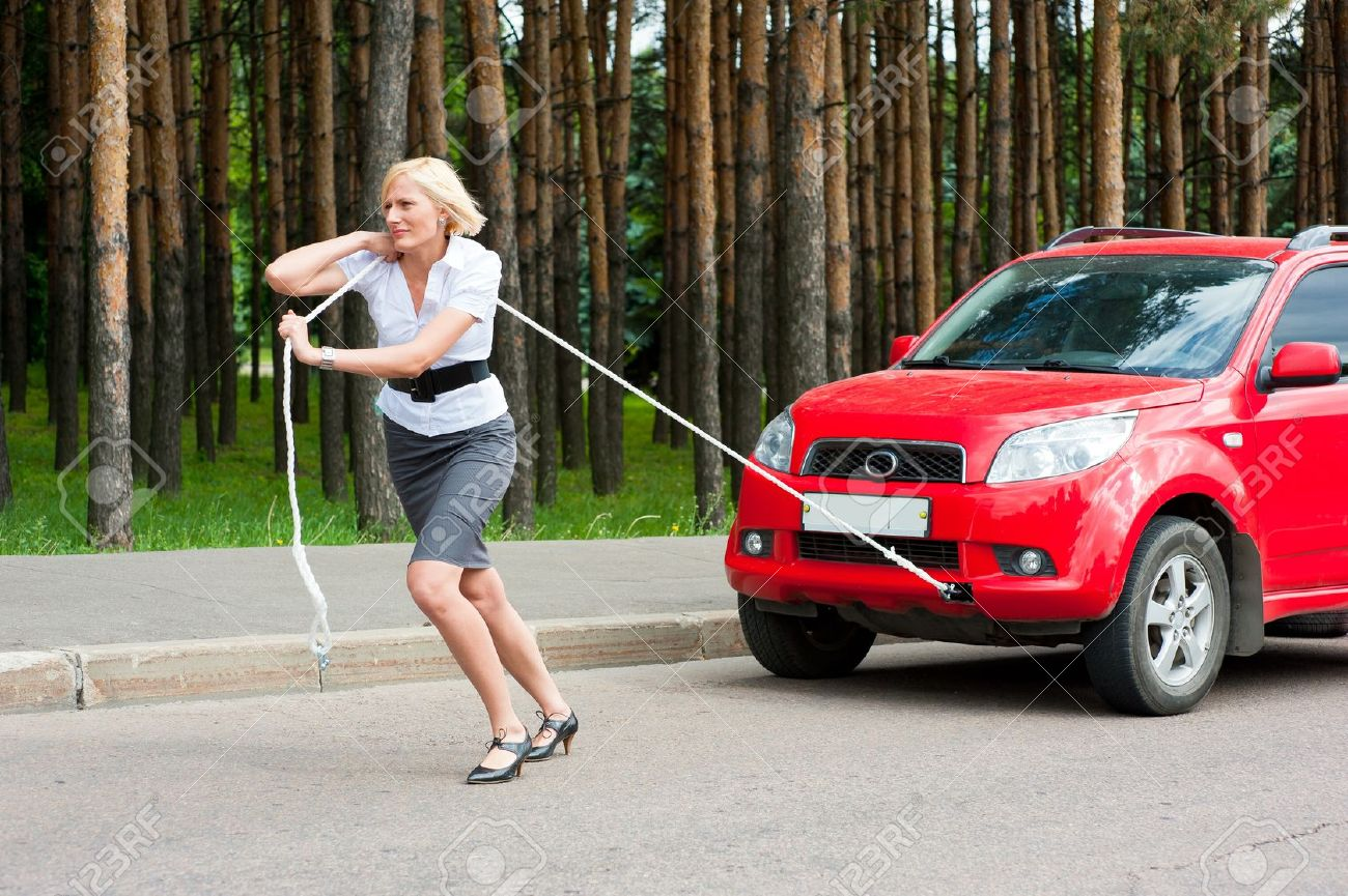10504120-blonde-girl-pulls-a-broken-car-with-a-rope-stock-photo-car-repair-accident