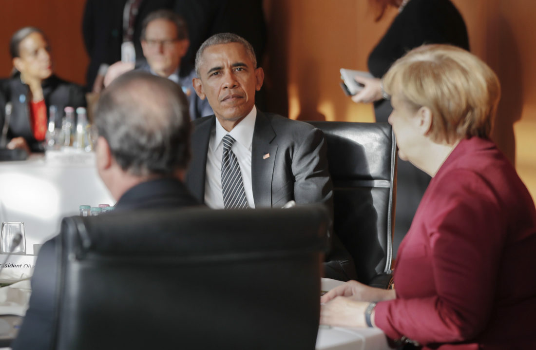President Barack Obama, center, meets with German Chancellor Angela Merkel, right, French President Francois Hollande, left, and other EU leaders at the German Chancellery in Berlin, Friday, Nov. 18, 2016. Obama is joining the leaders of key European countries to discuss an array of security and economic challenges facing the trans-Atlantic partners as the U.S. prepares for President-elect Donald Trump to take office in January. (AP Photo/Pablo Martinez Monsivais)