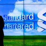 Profiturile trimestriale Standard Chartered au scăzut