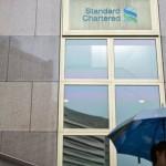 Profiturile Standard Chartered au scăzut cu 22% în 2015