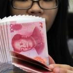 China devalorizează moneda pentru a doua zi consecutiv