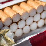 Axa opreste investitiile in industra tutunului