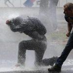"""""""Marșul foamei"""" în Venezuela: Poliția a intervenit cu gaze lacrimogene și gloanțe de cauciuc"""